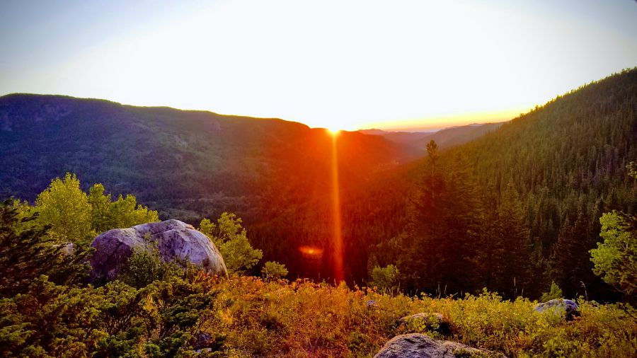 investment update mountain sunset