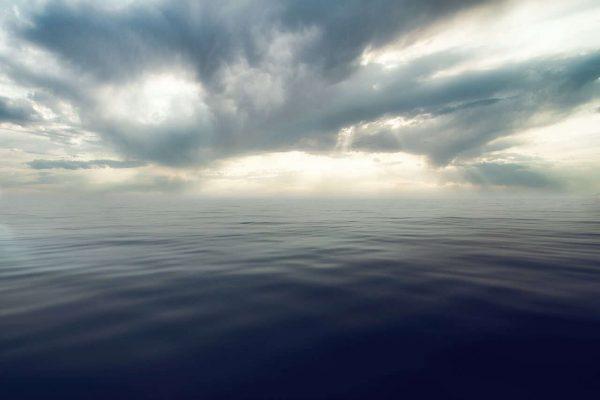 Market Storm Clouds Over Calm Sea